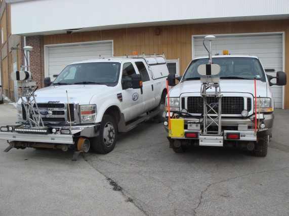 The two L-KOPIA Laser Trucks parked outside the L-KOPIA Garage and Shop in Crown Point, Indiana. The picture is taken before we started the upgrades on Feb. 4th, 2016.