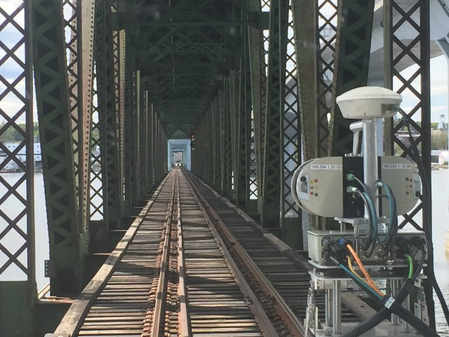 The L-KOPIA Excursion Laser Truck surveying the Kennebec River Bridge in Bath, Maine.