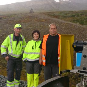 JBV Engineering personnel at a quick stop on the Arctic Circle (monument and some snow behind the group). From left Bjørn Biribakken, Janicke Oskarsen and Frank Woldsund.